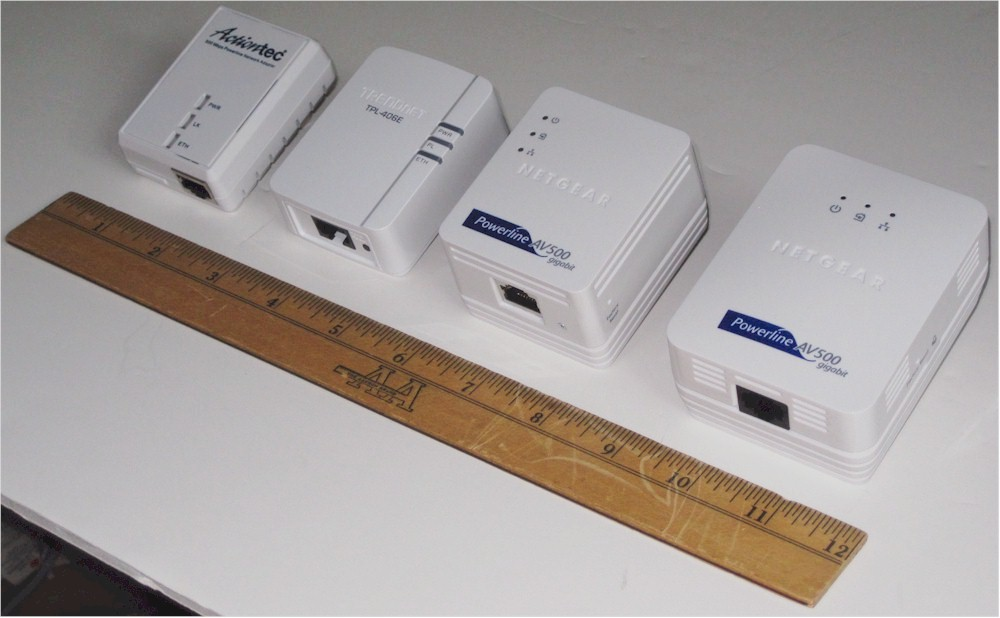 Adapter comparison size, left to right, Actiontec PWR500, TRENDnet TPL-406E2K, NETGEAR XAVB5101, NETGEAR XAVB5001