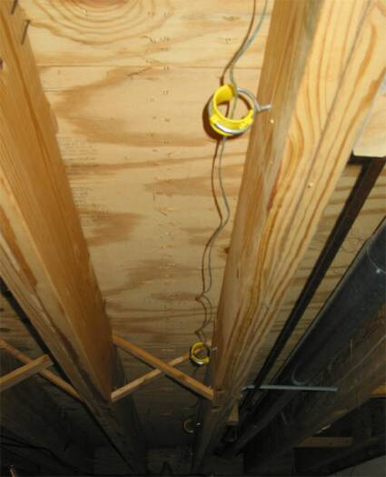 Cable hangers instead of drilling through joists