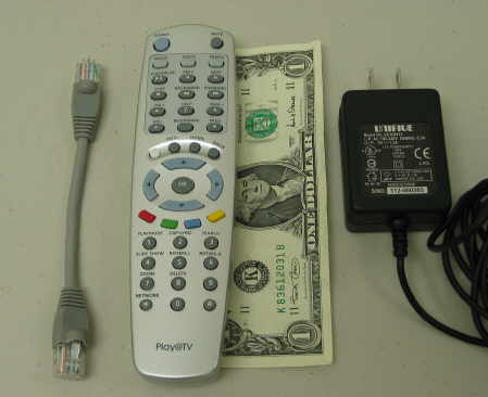 The remote is dollar-bill sized